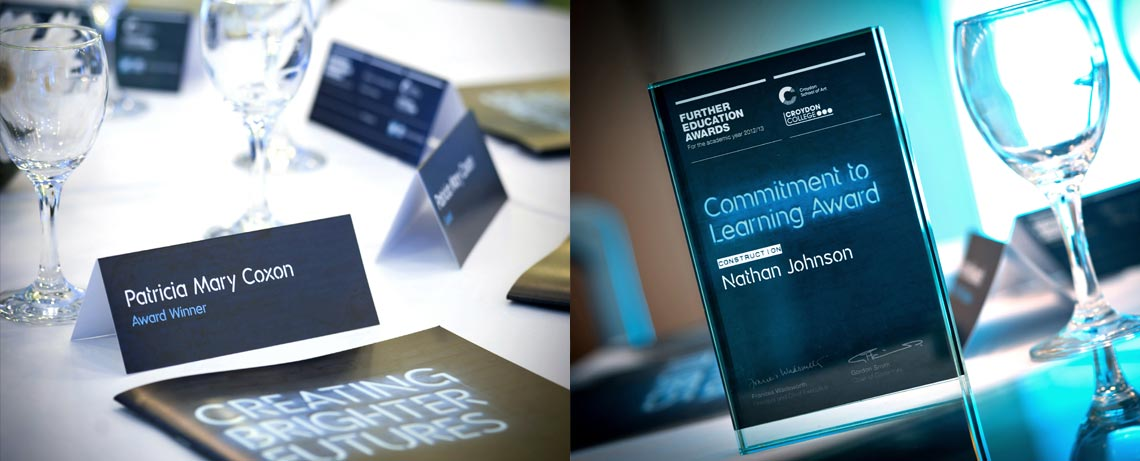 FE Awards branding on table cards and trophies